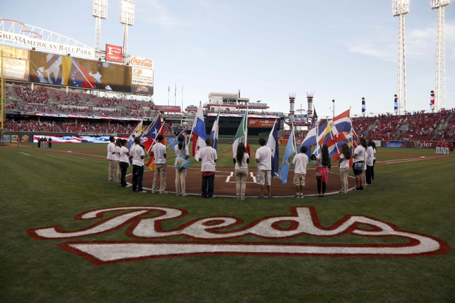 Sep 27, 2013; Cincinnati, OH, USA; A group of young people hold flags representing the countries of Latin America prior to a game between the Pittsburgh Pirates and the Cincinnati Reds at Great American Ball Park. Mandatory Credit: David Kohl-USA TODAY Sports