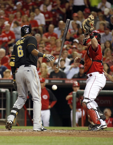 Sep 27, 2013; Cincinnati, OH, USA; Pittsburgh Pirates left fielder Starling Marte (6) is hit by a pitch in front of Cincinnati Reds catcher Ryan Hanigan (29) in the third inning at Great American Ball Park. Mandatory Credit: David Kohl-USA TODAY Sports