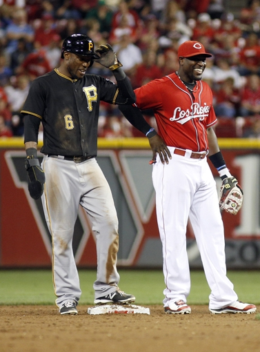 Sep 27, 2013; Cincinnati, OH, USA; Pittsburgh Pirates left fielder Starling Marte (6) and Cincinnati Reds second baseman Brandon Phillips (right) stand at second during their game at Great American Ball Park. Mandatory Credit: David Kohl-USA TODAY Sports