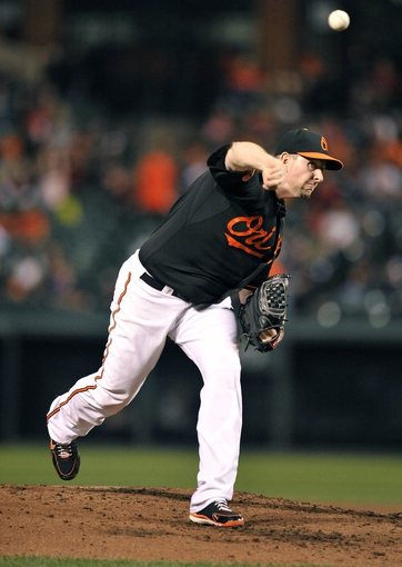 Sep 27, 2013; Baltimore, MD, USA; Baltimore Orioles starting pitcher Scott Feldman (34) throws the ball in the third inning against the Boston Red Sox at Oriole Park at Camden Yards. Mandatory Credit: Joy R. Absalon-USA TODAY Sports