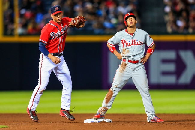 Sep 27, 2013; Atlanta, GA, USA; Philadelphia Phillies center fielder Cesar Hernandez (16) reacts to being caught stealing by Atlanta Braves shortstop Andrelton Simmons (19) in the sixth inning at Turner Field. Mandatory Credit: Daniel Shirey-USA TODAY Sports