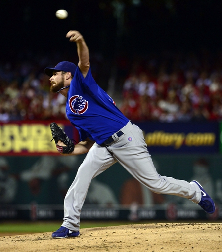 Sep 27, 2013; St. Louis, MO, USA; Chicago Cubs starting pitcher Travis Wood (37) delivers a pitch against the St. Louis Cardinals during the first inning at Busch Stadium. Mandatory Credit: Scott Rovak-USA TODAY Sports
