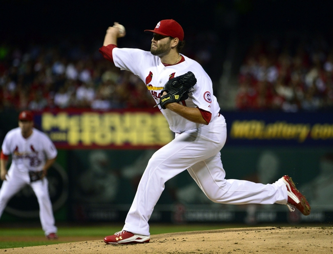 Sep 27, 2013; St. Louis, MO, USA; St. Louis Cardinals starting pitcher Lance Lynn (31) delivers a pitch against the Chicago Cubs at Busch Stadium. Mandatory Credit: Scott Rovak-USA TODAY Sports