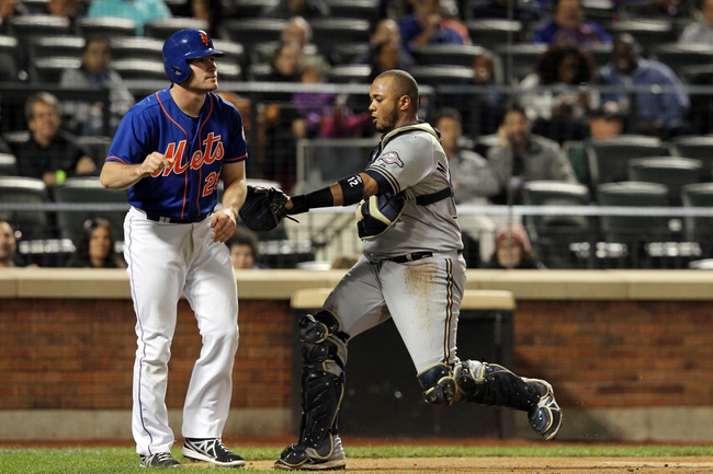 Sep 27, 2013; New York, NY, USA; New York Mets second baseman Daniel Murphy (28) is tagged out by Milwaukee Brewers catcher Martin Maldonado (12) after failing to touch home plate during the sixth inning of a game at Citi Field. Mandatory Credit: Brad Penner-USA TODAY Sports