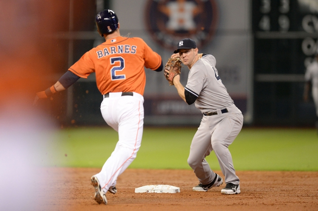 Sep 27, 2013; Houston, TX, USA; New York Yankees second baseman David Adams (45) forces an out on Houston Astros center fielder Brandon Barnes (2) during the third inning at Minute Maid Park. Mandatory Credit: Thomas Campbell-USA TODAY Sports