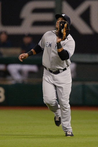 Sep 27, 2013; Houston, TX, USA; New York Yankees left fielder Zoilo Almonte (63) catches the ball against the Houston Astros during the third inning at Minute Maid Park. Mandatory Credit: Thomas Campbell-USA TODAY Sports