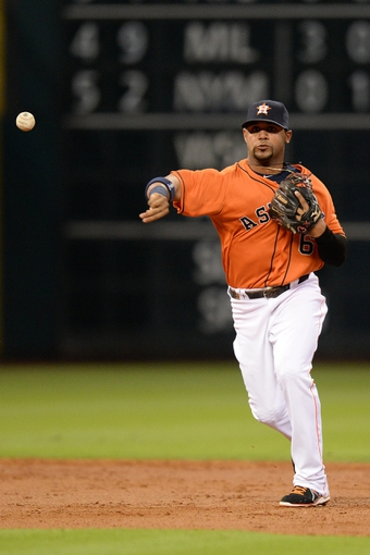 Sep 27, 2013; Houston, TX, USA; Houston Astros shortstop Jonathan Villar (6) throws out a runner against the New York Yankees during the third inning at Minute Maid Park. Mandatory Credit: Thomas Campbell-USA TODAY Sports