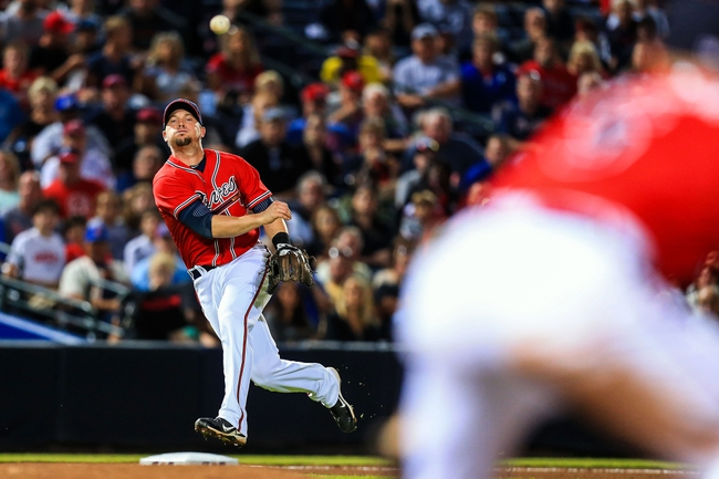 Sep 27, 2013; Atlanta, GA, USA; Atlanta Braves third baseman Chris Johnson (23) throws to first in an attempt to get the out in the sixth inning against the Philadelphia Phillies at Turner Field. Mandatory Credit: Daniel Shirey-USA TODAY Sports