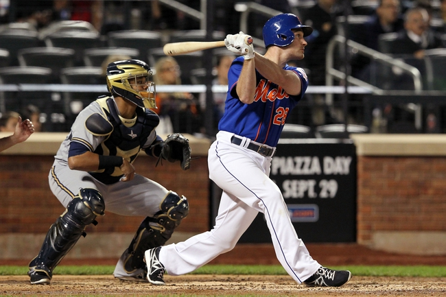Sep 27, 2013; New York, NY, USA; New York Mets second baseman Daniel Murphy (28) hits a grounds rule double against the Milwaukee Brewers during the sixth inning of a game at Citi Field. Mandatory Credit: Brad Penner-USA TODAY Sports