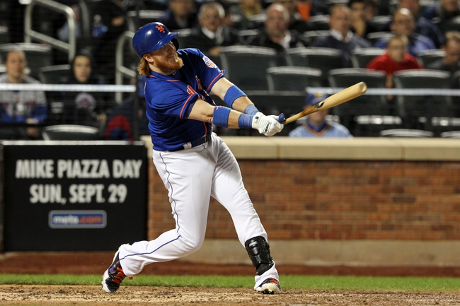 Sep 27, 2013; New York, NY, USA; New York Mets third baseman Justin Turner (2) hits an RBI infield single against the Milwaukee Brewers during the sixth inning at Citi Field. Mandatory Credit: Brad Penner-USA TODAY Sports