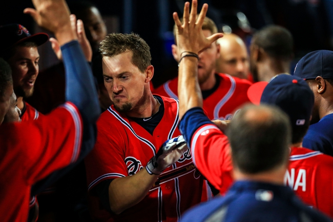 Sep 27, 2013; Atlanta, GA, USA; Atlanta Braves third baseman Chris Johnson (23) celebrates a solo home run in the eighth inning against the Philadelphia Phillies at Turner Field. Mandatory Credit: Daniel Shirey-USA TODAY Sports