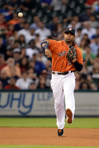 Sep 27, 2013; Houston, TX, USA; Houston Astros shortstop Jonathan Villar (6) throws out a runner against the New York Yankees during the fourth inning at Minute Maid Park. Mandatory Credit: Thomas Campbell-USA TODAY Sports