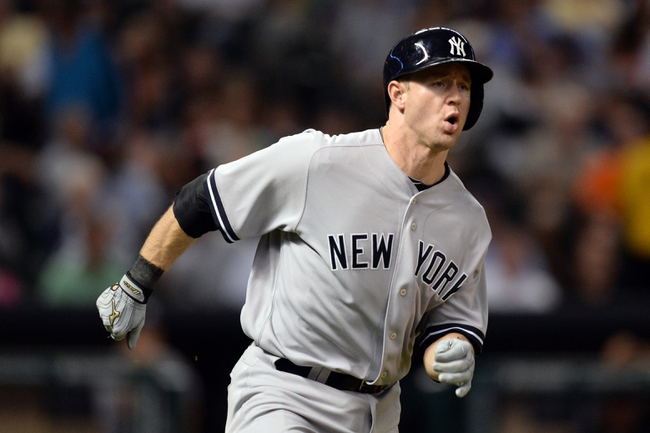 Sep 27, 2013; Houston, TX, USA; New York Yankees third baseman David Adams (45) runs to first after hitting a two-RBI double against the Houston Astros during the fourth inning at Minute Maid Park. Mandatory Credit: Thomas Campbell-USA TODAY Sports