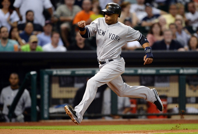 Sep 27, 2013; Houston, TX, USA; New York Yankees second baseman Robinson Cano (24) scores a run against the Houston Astros during the fourth inning at Minute Maid Park. Mandatory Credit: Thomas Campbell-USA TODAY Sports