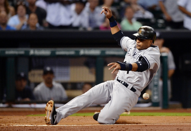 Sep 27, 2013; Houston, TX, USA; New York Yankees second baseman Robinson Cano (24) beats the ball to the plate to score a run against the Houston Astros during the fourth inning at Minute Maid Park. Mandatory Credit: Thomas Campbell-USA TODAY Sports