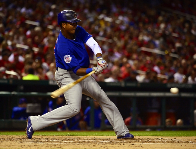 Sep 27, 2013; St. Louis, MO, USA; Chicago Cubs shortstop Starlin Castro (13) connects for his 2nd hit of the game against the St. Louis Cardinals at Busch Stadium. Mandatory Credit: Scott Rovak-USA TODAY Sports