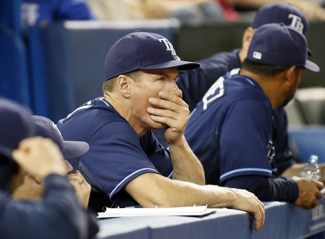 Sep 27, 2013; Toronto, Ontario, CAN; Tampa Bay Rays pitching coach Jim Hickey watches the action against the Toronto Blue Jays in the ninth inning at Rogers Centre. Toronto defeated Tampa Bay 6-3. Mandatory Credit: John E. Sokolowski-USA TODAY Sports