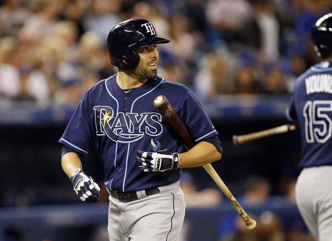 Sep 27, 2013; Toronto, Ontario, CAN; Tampa Bay Rays left fielder David DeJesus (7) reacts after striking out in the ninth inning against the Toronto Blue Jays at Rogers Centre. Toronto defeated Tampa Bay 6-3. Mandatory Credit: John E. Sokolowski-USA TODAY Sports