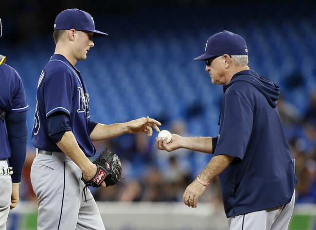 Sep 27, 2013; Toronto, Ontario, CAN; Tampa Bay Rays manager Joe Madden  takes out pitcher Jeff Beliveau (38) in the eighth inning against the Toronto Blue Jays at Rogers Centre. Toronto defeated Tampa Bay 6-3. Mandatory Credit: John E. Sokolowski-USA TODAY Sports