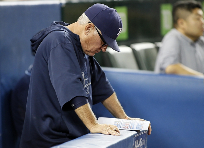 Sep 27, 2013; Toronto, Ontario, CAN; Tampa Bay Rays manager Joe Madden in the ninth inning against the Toronto Blue Jays at Rogers Centre. Toronto defeated Tampa Bay 6-3. Mandatory Credit: John E. Sokolowski-USA TODAY Sports
