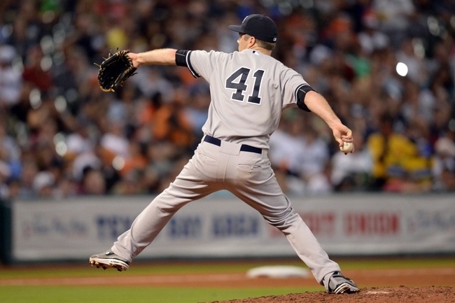 Sep 27, 2013; Houston, TX, USA; New York Yankees relief pitcher David Phelps (41) pitches against the Houston Astros during the sixth inning at Minute Maid Park. Mandatory Credit: Thomas Campbell-USA TODAY Sports