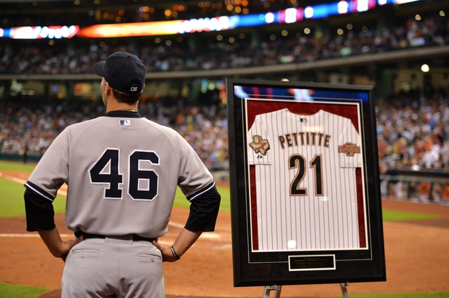 Sep 27, 2013; Houston, TX, USA; New York Yankees starting pitcher Andy Pettitte (46) watches highlights of his career with the Houston Astros during the fifth inning at Minute Maid Park. Mandatory Credit: Thomas Campbell-USA TODAY Sports