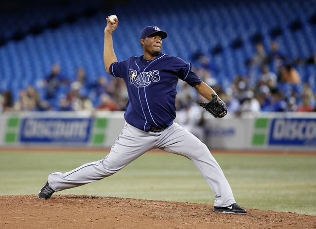 Sep 27, 2013; Toronto, Ontario, CAN; Tampa Bay Rays pitcher Roberto Hernandez (40) throws against the Toronto Blue Jays in the seventh inning at Rogers Centre. Toronto defeated Tampa Bay 6-3. Mandatory Credit: John E. Sokolowski-USA TODAY Sports