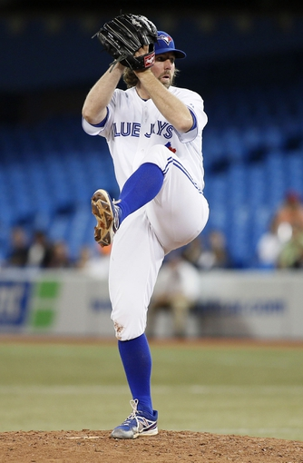 Sep 27, 2013; Toronto, Ontario, CAN; Toronto Blue Jays pitcher R.A. Dickey (43) pitches against the Tampa Bay Rays at Rogers Centre. Toronto defeated Tampa Bay 6-3. Mandatory Credit: John E. Sokolowski-USA TODAY Sports