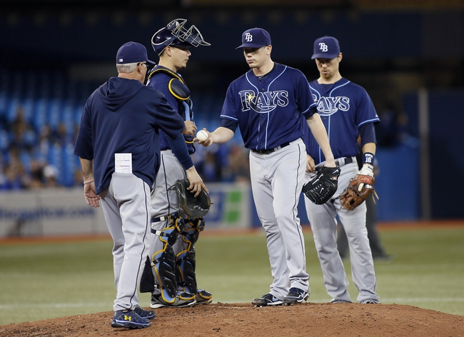 Sep 27, 2013; Toronto, Ontario, CAN; Tampa Bay Rays manager Joe Madden  takes starting pitcher Jeremy Hellickson (58) out of the game in the fifth inning against the Toronto Blue Jays at Rogers Centre. Toronto defeated Tampa Bay 6-3. Mandatory Credit: John E. Sokolowski-USA TODAY Sports