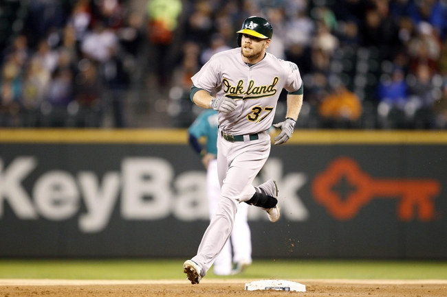 Sep 27, 2013; Seattle, WA, USA; Oakland Athletics designated hitter Brandon Moss (37) rounds the bases after hitting a three-run home run against the Seattle Mariners during the first inning at Safeco Field. Mandatory Credit: Joe Nicholson-USA TODAY Sports
