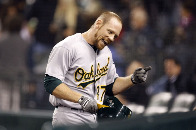 Sep 27, 2013; Seattle, WA, USA; Oakland Athletics designated hitter Brandon Moss (37) is greeted at the dugout after hitting a three-run home run against the Seattle Mariners during the first inning at Safeco Field. Mandatory Credit: Joe Nicholson-USA TODAY Sports