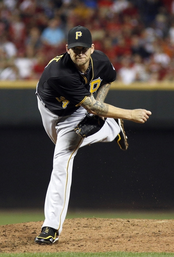 Sep 27, 2013; Cincinnati, OH, USA; Pittsburgh Pirates starting pitcher A.J. Burnett release a pitch against the Cincinnati Reds at Great American Ball Park. Mandatory Credit: David Kohl-USA TODAY Sports
