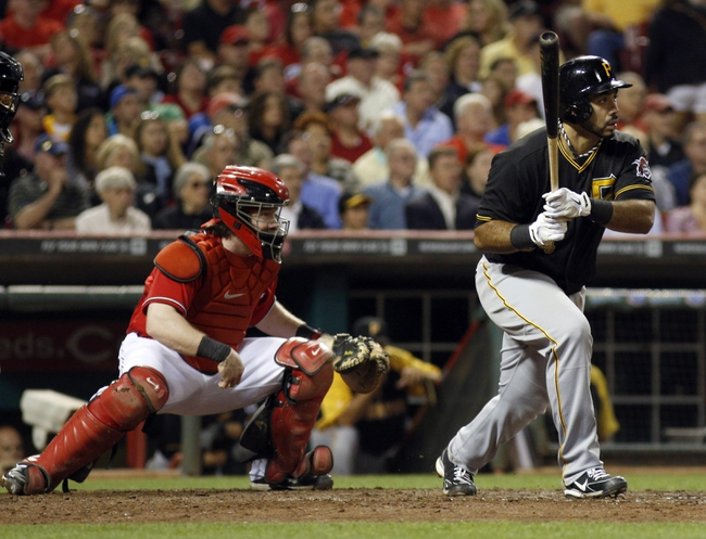 Sep 27, 2013; Cincinnati, OH, USA; Pittsburgh Pirates third baseman Pedro Alvarez hits a single against the Cincinnati Reds in the eighth inning at Great American Ball Park. Pittsburgh won 4-1. Mandatory Credit: David Kohl-USA TODAY Sports