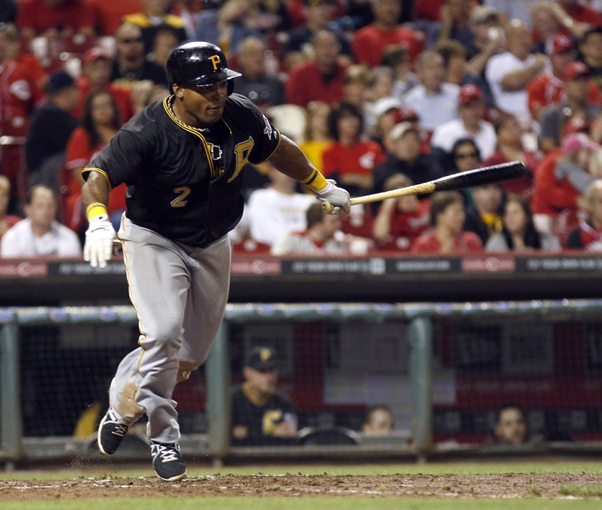Sep 27, 2013; Cincinnati, OH, USA; Pittsburgh Pirates right fielder Marlon Byrd hits a single against the Cincinnati Reds in the eighth inning at Great American Ball Park. Pittsburgh won 4-1. Mandatory Credit: David Kohl-USA TODAY Sports