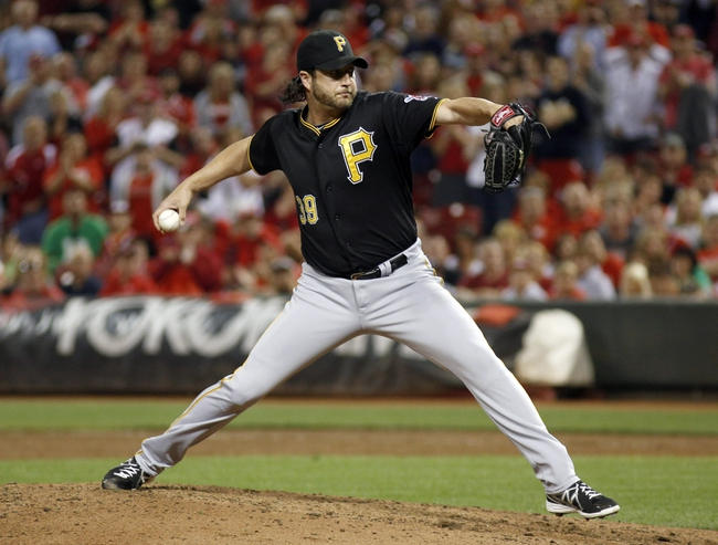 Sep 27, 2013; Cincinnati, OH, USA; Pittsburgh Pirates relief pitcher Jason Grilli throws against the Cincinnati Reds in the ninth inning at Great American Ball Park. Pittsburgh won 4-1. Mandatory Credit: David Kohl-USA TODAY Sports