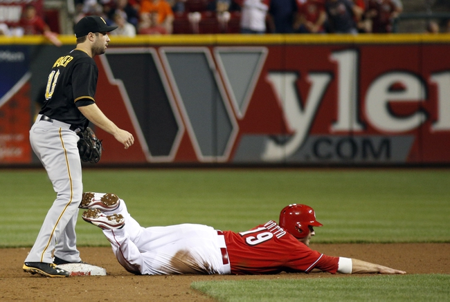 Sep 27, 2013; Cincinnati, OH, USA; Cincinnati Reds first baseman Joey Votto (19) is forced out at second under Pittsburgh Pirates second baseman Neil Walker (18) in the ninth inning at Great American Ball Park. Pittsburgh won 4-1. Mandatory Credit: David Kohl-USA TODAY Sports