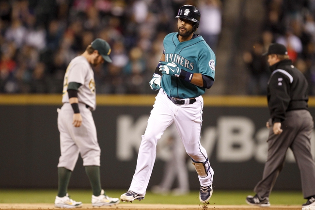Sep 27, 2013; Seattle, WA, USA; Seattle Mariners starting right fielder Franklin Gutiererez (21) rounds the bases after hitting a solo-homer against the Oakland Athletics during the first inning at Safeco Field. Mandatory Credit: Joe Nicholson-USA TODAY Sports