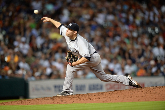 Sep 27, 2013; Houston, TX, USA; New York Yankees relief pitcher David Phelps (41) pitches against the Houston Astros during the seventh inning at Minute Maid Park. Mandatory Credit: Thomas Campbell-USA TODAY Sports