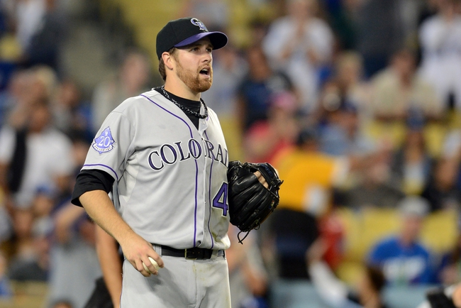 Sep 27, 2013; Los Angeles, CA, USA; Colorado Rockies starting pitcher Collin McHugh (43) reacts in the first inning against the Los Angeles Dodgers at Dodger Stadium. Mandatory Credit: Jayne Kamin-Oncea-USA TODAY Sports