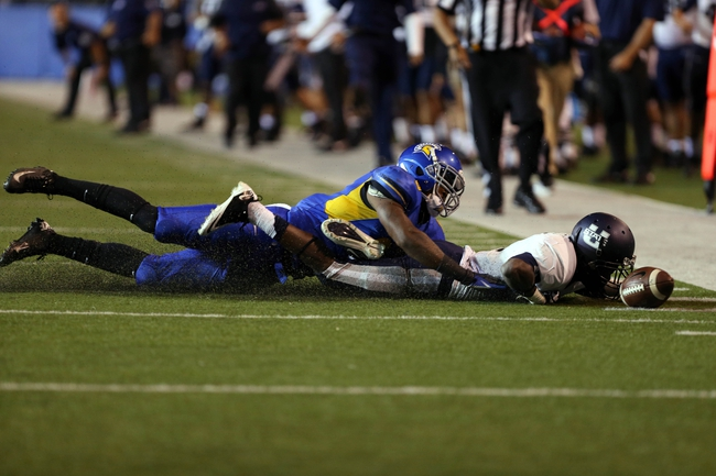 Sep 27, 2013; San Jose, CA, USA; Utah State Aggies wide receiver Bruce Natson (9) is unable to control the ball ahead of San Jose State Spartans cornerback Jimmy Pruitt (8) during the second quarter at Spartan Stadium. Mandatory Credit: Kelley L Cox-USA TODAY Sports