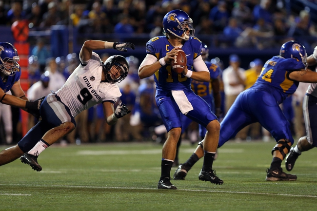 Sep 27, 2013; San Jose, CA, USA; San Jose State Spartans quarterback David Fales (10) looks to pass the ball with pressure from Utah State Aggies linebacker Kyle Fackrell (9) during the second quarter at Spartan Stadium. Mandatory Credit: Kelley L Cox-USA TODAY Sports