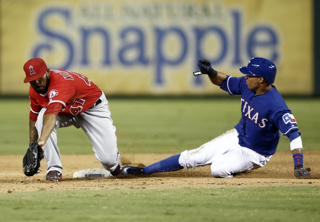 Sep 27, 2013; Arlington, TX, USA; Texas Rangers center fielder Leonys Martin (2) safely steals second ahead of the tag by Los Angeles Angels second baseman Howie Kendrick (47) during the eighth inning of a baseball game at Rangers Ballpark in Arlington. The Rangers won 5-3. Mandatory Credit: Jim Cowsert-USA TODAY Sports