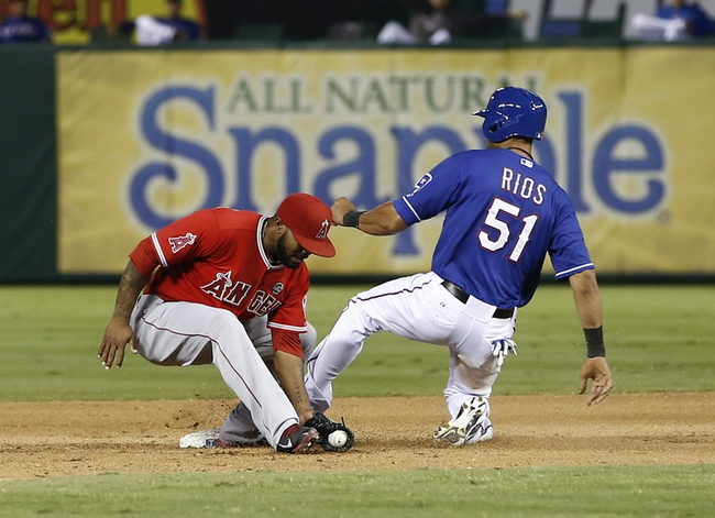 Sep 27, 2013; Arlington, TX, USA; Texas Rangers right fielder Alex Rios (51) safely steals second ahead of the tag by Los Angeles Angels second baseman Howie Kendrick (47) during the seventh inning of a baseball game at Rangers Ballpark in Arlington. The Rangers won 5-3. Mandatory Credit: Jim Cowsert-USA TODAY Sports
