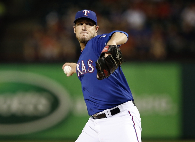 Sep 27, 2013; Arlington, TX, USA; Texas Rangers relief pitcher Joe Nathan (36) delivers to the Los Angeles Angels during the ninth inning of a baseball game at Rangers Ballpark in Arlington. The Rangers won 5-3. Mandatory Credit: Jim Cowsert-USA TODAY Sports