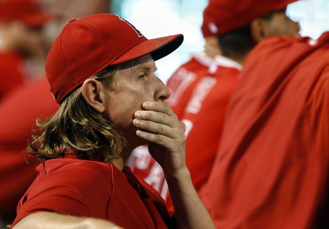 Sep 27, 2013; Arlington, TX, USA; Los Angeles Angels pitcher Jered Weaver (36) looks on from the dugout during the seventh inning of a baseball game against the Texas Rangers at Rangers Ballpark in Arlington. The Rangers won 5-3. Mandatory Credit: Jim Cowsert-USA TODAY Sports
