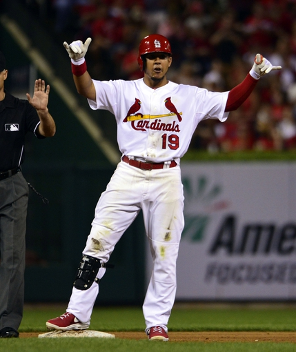 Sep 27, 2013; St. Louis, MO, USA; St. Louis Cardinals center fielder Jon Jay (19) celebrates hitting a double against the Chicago Cubs at Busch Stadium. The Cardinals defeated the Cubs 7-0 to win the National League Central Title. Mandatory Credit: Scott Rovak-USA TODAY Sports