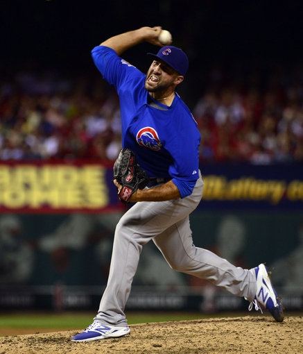 Sep 27, 2013; St. Louis, MO, USA; Chicago Cubs relief pitcher Blake Parker (50) delivers a pitch against the St. Louis Cardinals at Busch Stadium. The Cardinals defeated the Cubs 7-0 to win the National League Central Title. Mandatory Credit: Scott Rovak-USA TODAY Sports