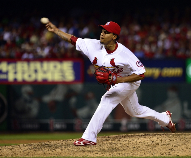 Sep 27, 2013; St. Louis, MO, USA; St. Louis Cardinals relief pitcher Carlos Martinez (62) delivers a pitch against the Chicago Cubs at Busch Stadium. The Cardinals defeated the Cubs 7-0 to win the National League Central Title. Mandatory Credit: Scott Rovak-USA TODAY Sports