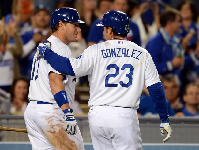 Sep 27, 2013; Los Angeles, CA, USA; Los Angeles Dodgers first baseman Adrian Gonzalez (23) with catcher A.J. Ellis (17) after a home run in the third inning of the game against the Colorado Rockies at Dodger Stadium. Mandatory Credit: Jayne Kamin-Oncea-USA TODAY Sports