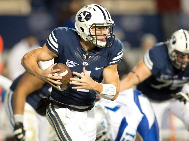 Sep 27, 2013; Provo, UT, USA; Brigham Young Cougars quarterback Taysom Hill (4) runs with the ball during the second half against the Middle Tennessee Blue Raiders at Lavell Edwards Stadium. Brigham Young won 37-10. Mandatory Credit: Russ Isabella-USA TODAY Sports